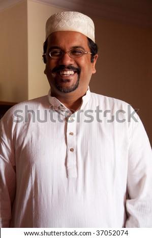 A modern Muslim man wearing traditional dress - stock photo