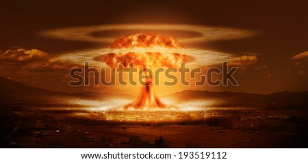 A modern nuclear bomb explosion over a small city - stock photo