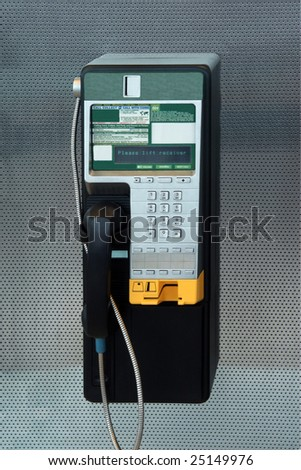 A modern payphone on a silver background