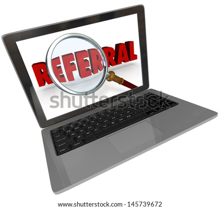 A modern silver or aluminum laptop computer with a screen showing a magnifying glass over the word Referral to illustrate the search for a recommendation or someone to refer you - stock photo
