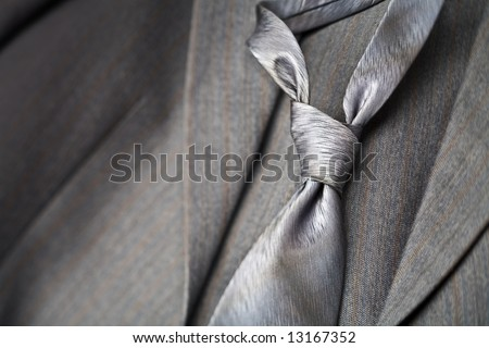A modern tie and a gray costume