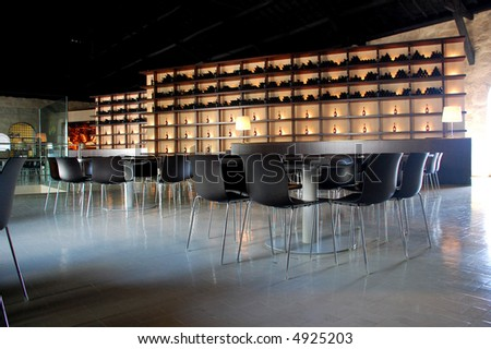 a modern vineyard cave with old bottles - stock photo