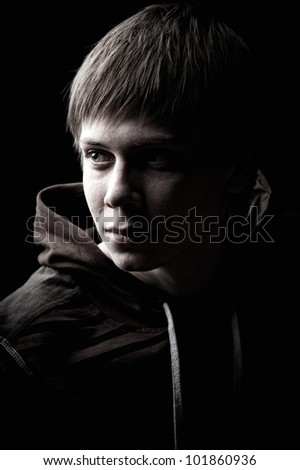 A modest glance to the side from a handsome male model. - stock photo
