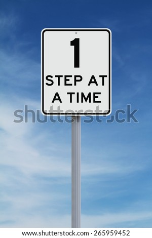 A modified speed limit sign indicating One Step at a Time  - stock photo