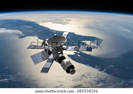 A modified version of Skylab - satellite laboratory for scientific experiments, orbiting over New Zealand - 3D Scene. Elements of this illustration furnished by NASA. - stock photo
