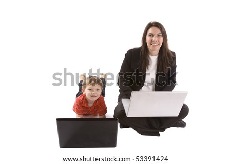 A mom and her son both working on laptop computers and looking up.