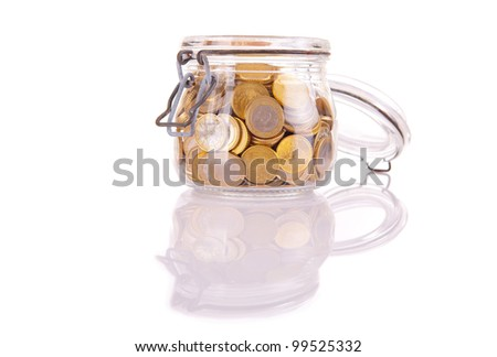 A Money jar full of savings - stock photo