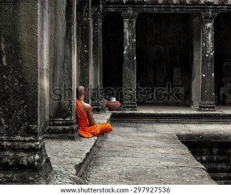 A monk meditates at the Angkor Wat temple in Siem Reap Cambodia. - stock photo