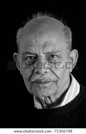 A monochromatic image of a senior Indian man - stock photo