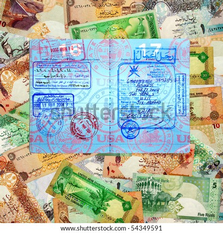 A montage of various currencies from several different Middle Eastern countries serving as a background to a U.S. Passport with Middle Eastern VISA's and entry/exit stamps - stock photo
