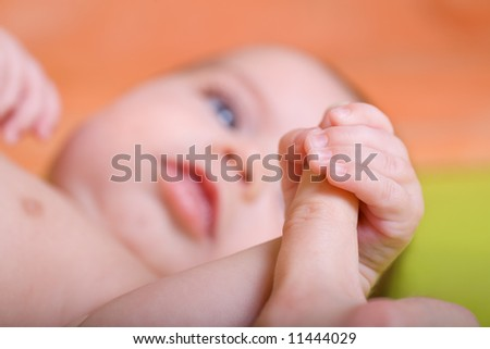 a 3 month old baby in front of nursery