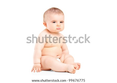 A 9 months old baby in diapers sitting isolated on white background