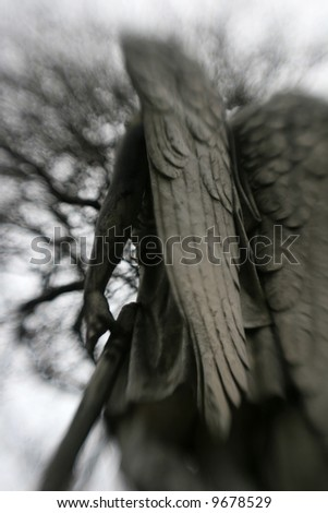 A moody photo of a gravestone angel - stock photo
