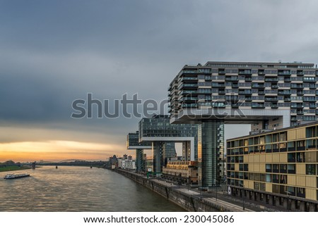 A moody riverside image of architecture on the banks of the river rhine in germany - stock photo