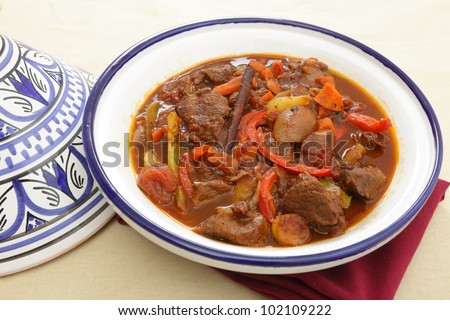 A moroccan beef tagine served in the traditional tagine dish. The casserole uses beef, onion, carrots, capsicums, a cinnamon stick and a traditional mix of spices known as ras el hanout