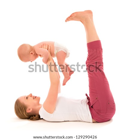 A mother and baby gymnastics, yoga exercises - stock photo