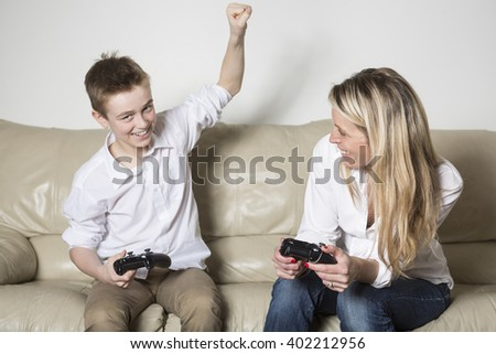 A mother and child playing a video game - stock photo
