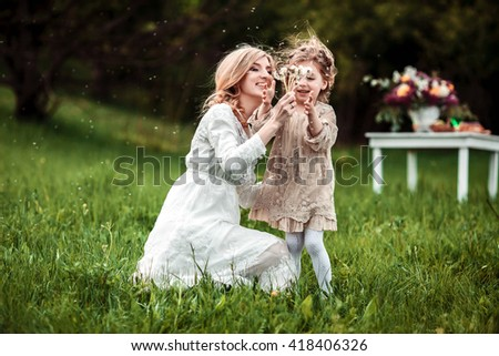 A mother and child playing and having fun in nature. The concept of life values and happiness - stock photo