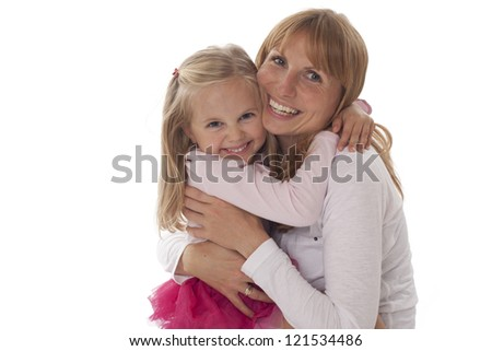 A mother and daughter smiling and hugging. Photographed in the studio and isolated against a white background.