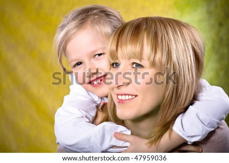 a mother and daughter studio portrait