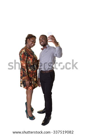 A mother and her teenage son take a picture of themselves on a cell phone