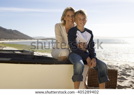 A mother and son sitting on a boat