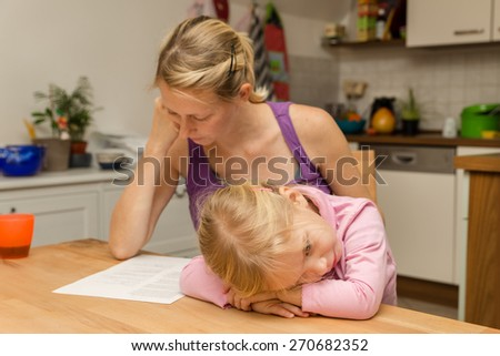 a mother disregard her tired little daughter - stock photo