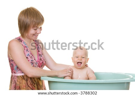 A mother washing her baby, isolated on white - stock photo