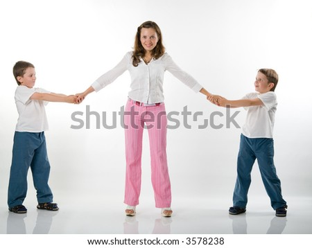 A mother with two twin brothers, isolated