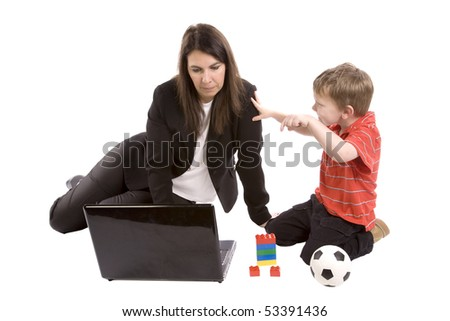 A mother working on her computer while the son tries to play. - stock photo