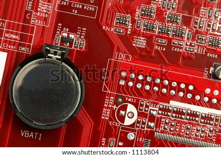 A motherboard close up showing the battery and some circuits - stock photo