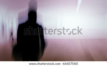 A motion blurred image of a Man and background - stock photo