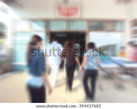 A motion blurred photograph of a patient on stretcher or gurney being pushed at speed through a hospital to emergency room - stock photo