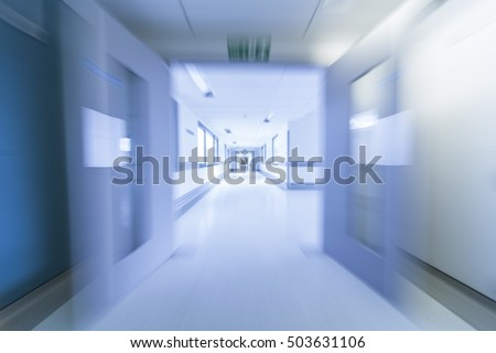 A motion blurred photograph of an empty hospital corridor