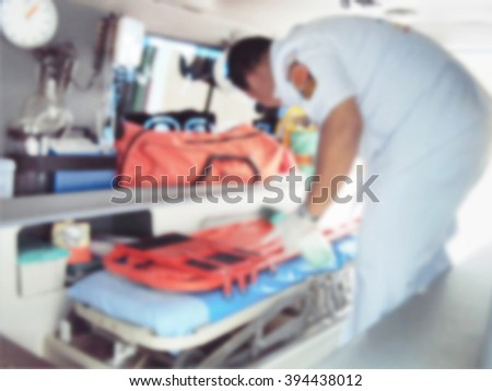 A motion blurred photograph of inside of an ambulance - stock photo
