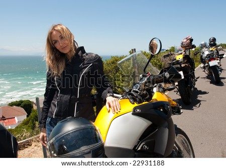 A motorcycle portrait of a beautiful young woman. - stock photo