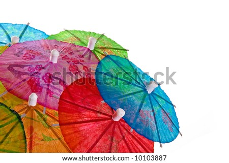 A mound of multi-colored cocktail umbrellas isolated on white. - stock photo