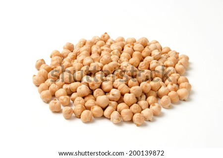 A mound of organic dried garbanzo beans on a white background - stock photo