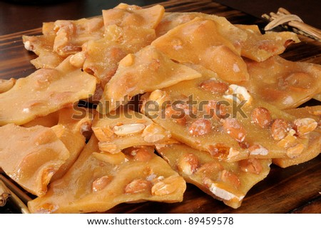 A mound of peanut brittle - stock photo