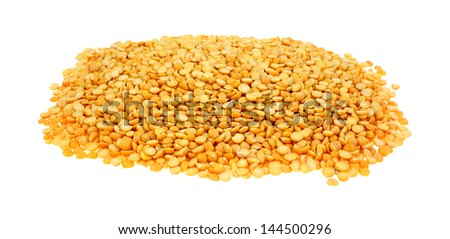A mound of raw yellow split peas ready to cook. - stock photo