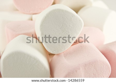 A mound of white and pink marshmallows.