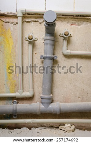 a mount new pipe on wall - stock photo