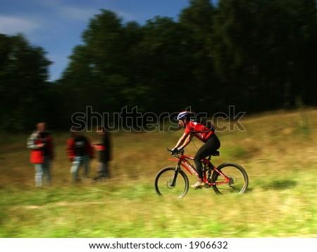 A Mountain biker on high speed - stock photo