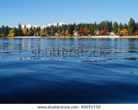 A Mountain Lake Under a Deep Blue Sky Coeur d'Alene Idaho USA - stock photo