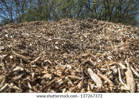 A mountain of wood chip in landscape - stock photo