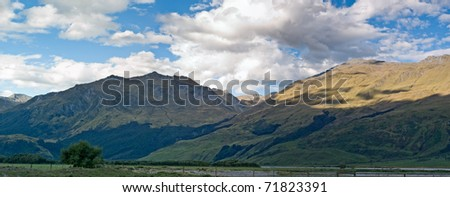 A mountain range in New Zealand during sunset - stock photo
