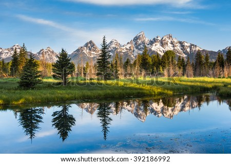A Mountain Range with Its Reflection, Grand Teton National Park, USA.  Landscape is unique and part of Rocky Mountain. Grand Teton National Park is also popular among landscape and nature photographer - stock photo