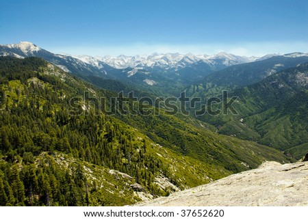 A mountaintop view of a valley vista within the Sierra Nevada mountain chain