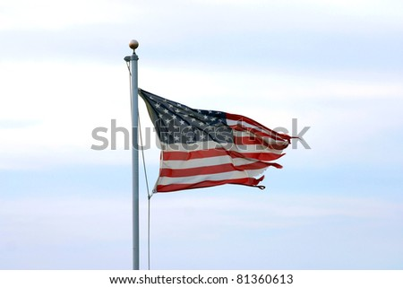 A much tattered but unbowed American Flag - stock photo