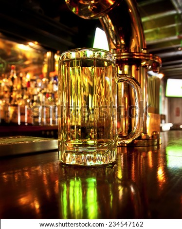 A mug of beer on a bar - stock photo
